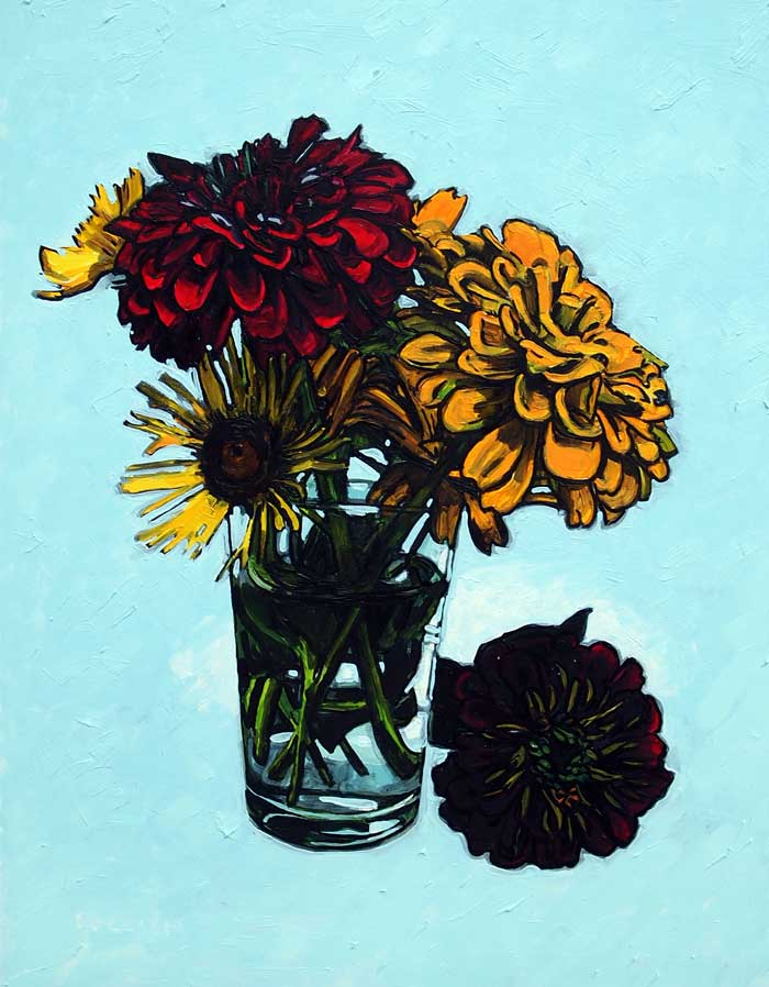 Zinnias in a water glass